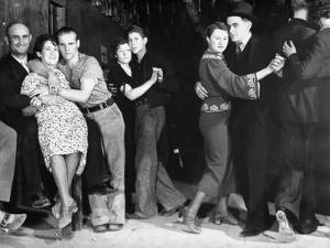 Construction Workers and Taxi Dancers Enjoying a Night Out in Barroom in Frontier Town by Margaret Bourke-White