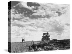 Couple on Field Being Harrowed at Verblud State Collective Farm, South of Moscow, Rostov, Russia by Margaret Bourke-White