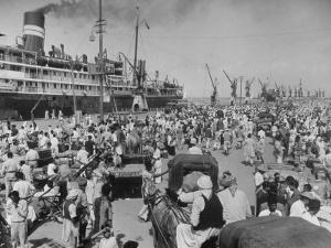 Crowd of Hindu Refugees Crowding Dock as They Prepare to Ship Out for New Homes in Bombay by Margaret Bourke-White