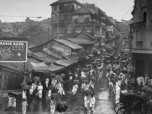 Crowds under Umbrellas on Street Outside Bombay Cotton Exchange During Monsoon Season by Margaret Bourke-White