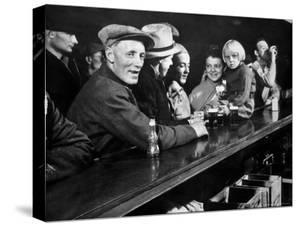 Dam Workers with Family Members Enjoying Beer at Local Bar by Margaret Bourke-White