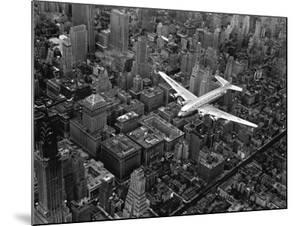 Douglas 4 Flying over Manhattan by Margaret Bourke-White