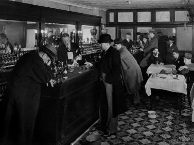 Drunk Male Patron at an Speakeasy in the Business District Protected From Police Prohibition Raids
