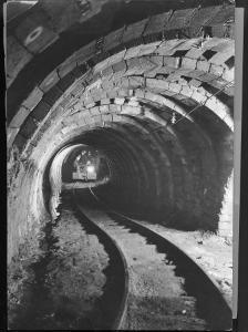 Electric Locomotive on Track in Powderly Anthracite Coal Mine Gangway, Owned by Hudson Coal Co by Margaret Bourke-White