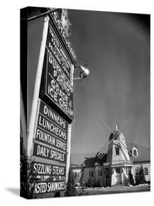 Electric Sign in Front of Restaurant Featuring Dutch Windmill Theme on Roadside of US Highway 1 by Margaret Bourke-White