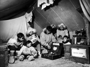 Eskimo Family Admiring their Modern Conveniences, a Victrola, a Sewing Machine and a Stove by Margaret Bourke-White