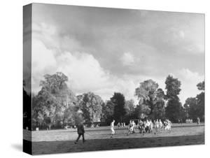 Eton College Students Playing Rugby on the Playing Fields at the School by Margaret Bourke-White