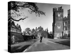 Eton Student in Traditional Tails and Topper Walking in Front of Weston Yard by Margaret Bourke-White
