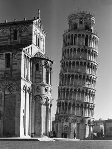 Famed Leaning Tower of Pisa Standing Next to the Baptistry of the Cathedral by Margaret Bourke-White
