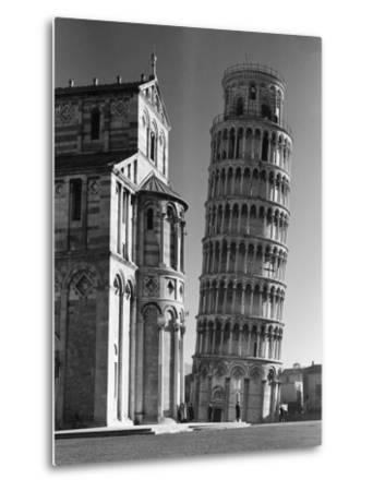 Famed Leaning Tower of Pisa Standing Next to the Baptistry of the Cathedral