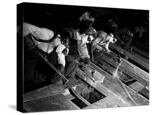"Female ""Burners"" Using Acetylene Torches to Bevel Armor Plate For Tanks at Steel Works by Margaret Bourke-White"