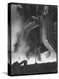 Female Metallurgist Peering Through an Optical Pyrometer to Determine the Temperature of Steel by Margaret Bourke-White