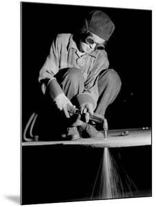 Female Welder at Work in a Steel Mill, Replacing Men Called to Duty During World War II by Margaret Bourke-White