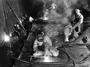 Female Welders Welding Seams on Deck Section of an Aircraft Carrier under Construction at Shipyard by Margaret Bourke-White