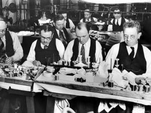 Finishers Assembling Pieces of Garments at Germaine Monteil Garment Factory by Margaret Bourke-White