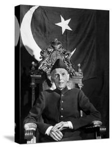 First Gov. Gen. of Independent Pakistan Mohammed Ali Jinnah Sitting in Front of Pakistani Flag by Margaret Bourke-White