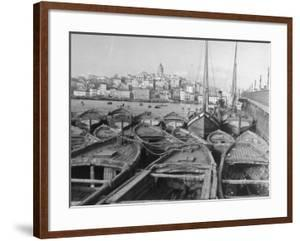 Fishing Boats Tied Up in the Golden Horn Looking Toward Galata Tower and the City by Margaret Bourke-White