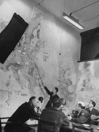 Gen. Eaken in Briefing Session by Intelligence Officer Lt. Parton, Uses Pointer on Huge Map