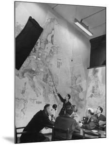 Gen. Eaken in Briefing Session by Intelligence Officer Lt. Parton, Uses Pointer on Huge Map by Margaret Bourke-White