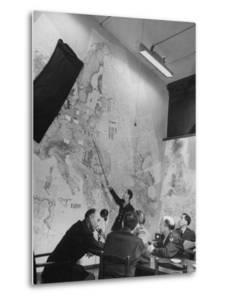 Gen. Eaken in Briefing Session by Intelligence Officer Lt. Parton, Uses Pointer on Huge Map by Margaret Bourke-White