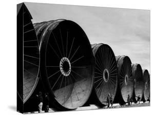 Gigantic Pipe Segments Used for Diverting the Missouri River During Construction of Fort Peck Dam by Margaret Bourke-White