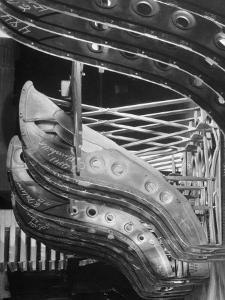 Harp-Shaped Steel String Frames in Racks Waiting to be Installed at the Steinway Piano Factory by Margaret Bourke-White