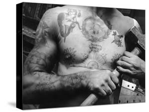 Heavily Tattooed Chest and Arms of Workman at the Bethlehem Ship Building Co by Margaret Bourke-White