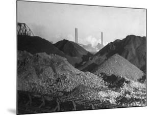 Huge Heaps of Iron Ore Outside Steel Plant, Brought in by Shipping Along the Great Lakes by Margaret Bourke-White