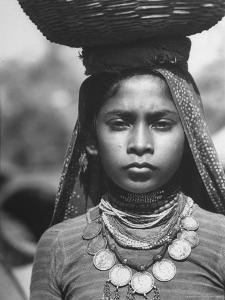 India Native Wearing Traditional Clothing, Carrying Basket on Her Head by Margaret Bourke-White