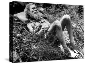 Indian Fakir Sleeping on a Bed of Thorns as He Shuns Pain While Practicing His Religious Asceticism by Margaret Bourke-White