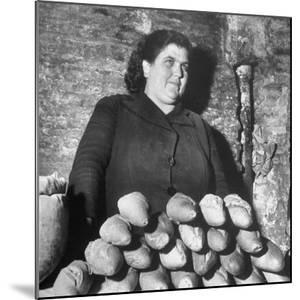 Italian Woman Selling Bread in Her Black Market Street Stall on the Tor Di Nono by Margaret Bourke-White