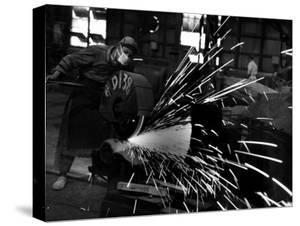 Japanese Worker Cutting Steel Pipe W. Huge Power Saw at Yawata Steel Mill by Margaret Bourke-White