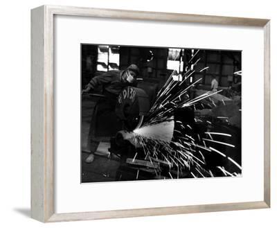 Japanese Worker Cutting Steel Pipe W. Huge Power Saw at Yawata Steel Mill