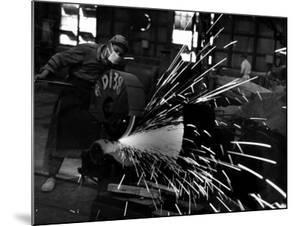 Japanese Worker Cutting Steel Pipe W. Huge Power Saw at Yawata Steel Mill by Margaret Bourke-White