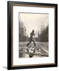 Log Driver Leaping Across Floating Logs to Keep Them Moving by Breaking Loose Any That Get Jammed by Margaret Bourke-White