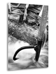 Log Driver's Feet Using a Peavey, to Control Lumber Floating Down River Headed for Paper Mill by Margaret Bourke-White
