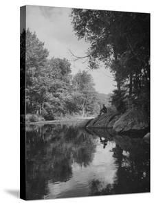 Man Sitting on the Bank of the Upper Opalescent River, a Branch of the Hudson by Margaret Bourke-White