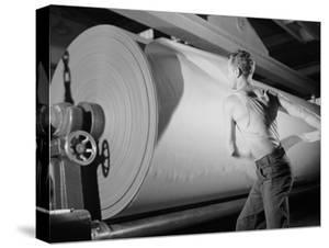 Man Working at Roller in Paper Factory by Margaret Bourke-White