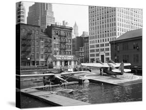 Manhattan's East River Downtown Skyport - Grumman and Fairchild Amphibious Planes by Margaret Bourke-White