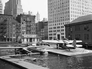 Manhattan's East River Downtown Skyport - Grumman and Fairchild Amphibious Planes by Margaret Bourke-White