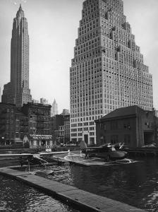 Manhattan's East River Downtown Skyport with Grumman and Fairchild Amphibious Planes by Margaret Bourke-White
