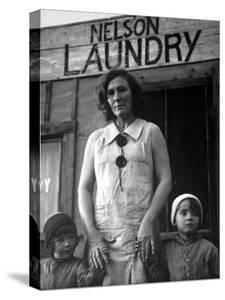 Mrs. Nelson with Her Two Children Outside Her Laundry Which She Operates without Running Water by Margaret Bourke-White