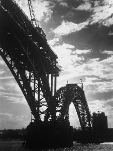 Multiple Arc Bridge under Construction Across the Dnieper River Below the World's Largest Dam by Margaret Bourke-White