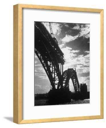 Multiple Arc Bridge under Construction Across the Dnieper River Below the World's Largest Dam
