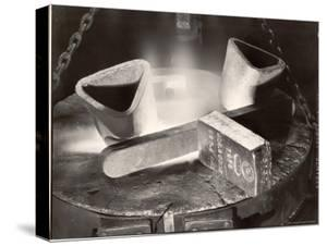 Newly Stamped Bar of Gold Resting on the Lip of a Melting Furnace at the Us Assay Office by Margaret Bourke-White