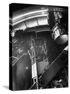 Night Assistant Climbing Down Side of 100-Inch Telescope at Mount Wilson Observatory by Margaret Bourke-White