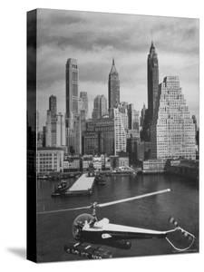 Nyc Police Helicopter Passing over Downtown Skyport on the Waterfront in Lower Manhattan by Margaret Bourke-White