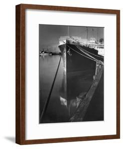 Oil Tanker Tied Up at Dock While it Is Being Loaded with Barrels of Oil by Margaret Bourke-White