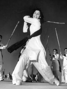 Pakistani Members of the Sind Muslim Women's National Guard Practicing Combat by Margaret Bourke-White