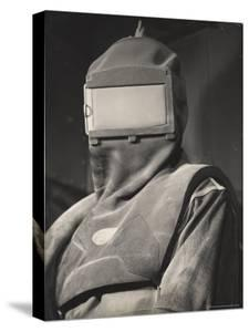 Paul Bakiel Wearing Protective Helmet and Heavy Canvas Clothing at Aluminum Co. of America Plant by Margaret Bourke-White